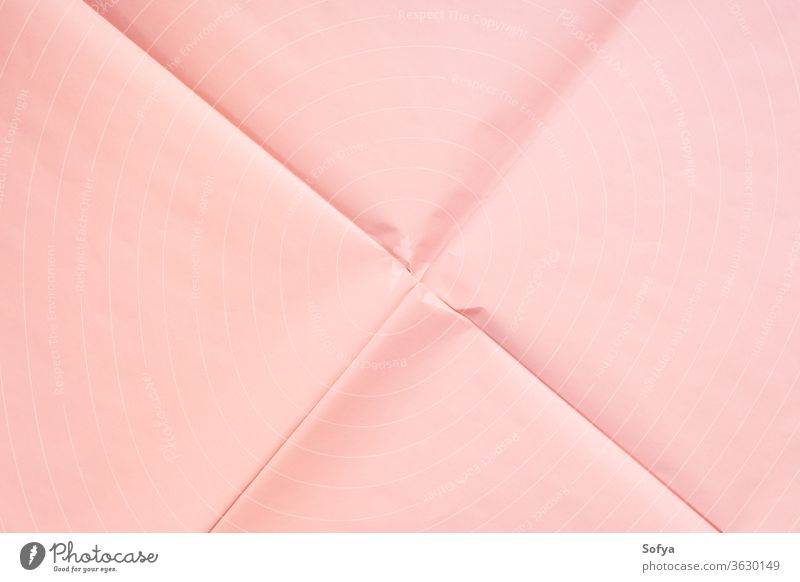 Pink paper background with crease texture pink coral wrapping geometry abstract art concept backdrop modern copy space mockup color year pastel trendy minimal