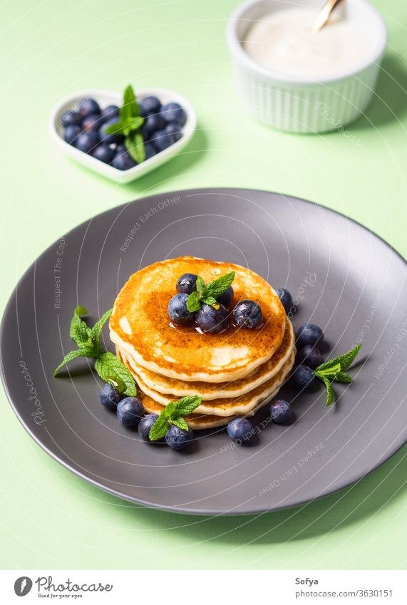 Home made pancakes served with fresh berries american breakfast food blueberry beautiful cooked culinary delicious dessert fluffy fried brunch healthy homemade