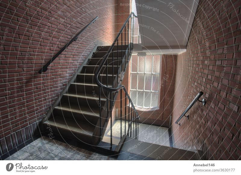 Stairwell in appartment building with brick wall, staircase antique old style complex with tall windows interior architecture stairwell design house stairs