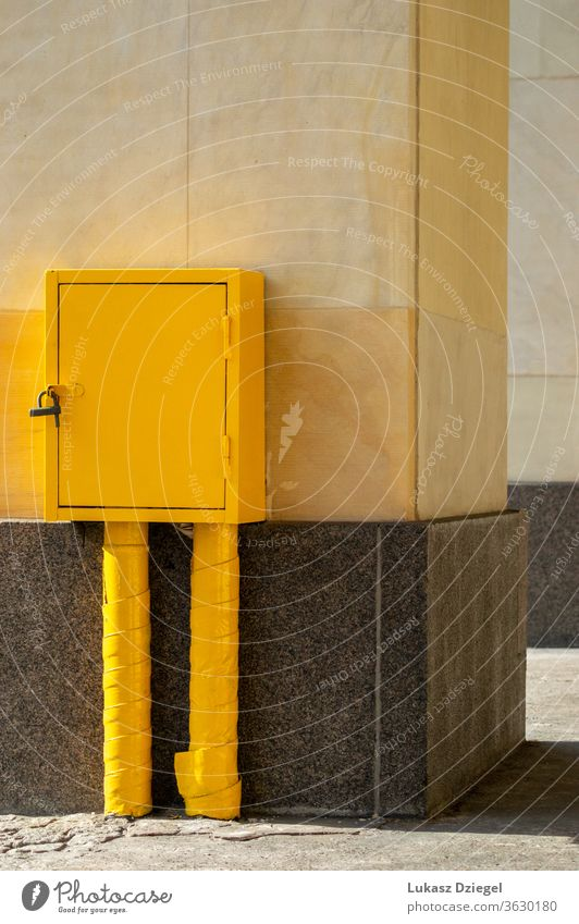 Yellow metal box textured lock hardware steel outdoors yellow box background black container open metallic object comfortable closeup build single tool easy