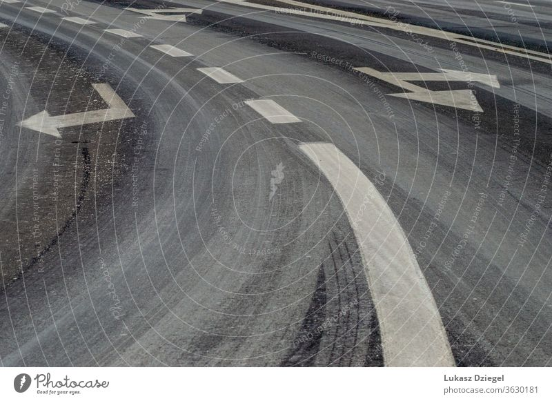 Fragment of asphalt road with painted stripes and arrows outdoor ahead lane notification nobody roadside drive automotive direction pedestrian urban