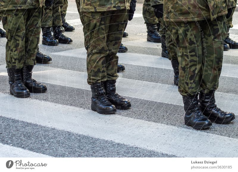 Soldiers standing on the street in a military uniform with camouflage and black military boots soldiers troops combat boots boot camp platoon veterans day