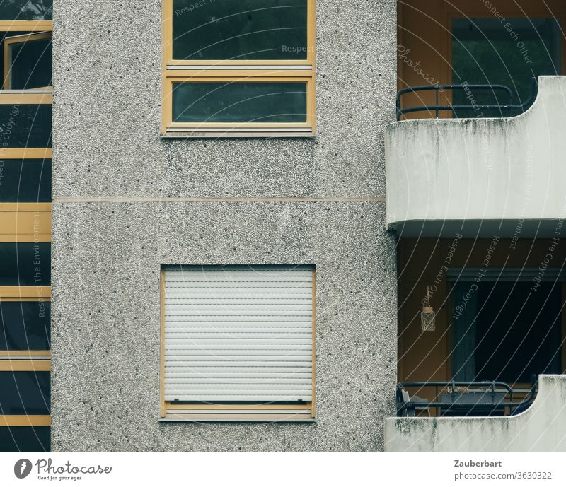 Facade of a residential house, windows and balcony made of concrete in Neukölln House (Residential Structure) High-rise social housing Apartment Building