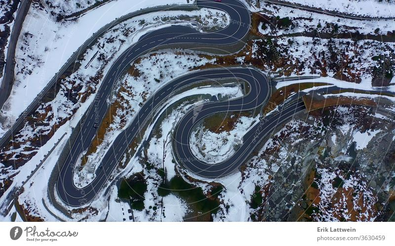 Top down view over a pass street in the Swiss mountains on a win snow landscape winter snowy cover beautiful scene forest alp background cold fairytale fir
