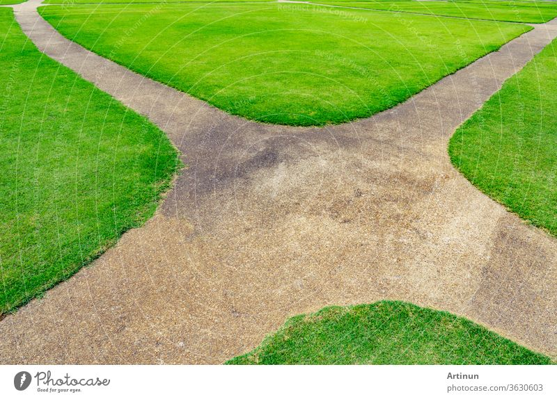 Pathway on the green lawn texture background. Intersection walkway abstract area backdrop beautiful clean closeup color competition crossroads curve design