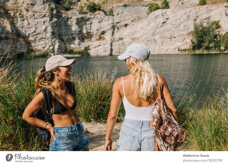 Best female friends near lake during holiday best friend carefree women girlfriend vacation admire landscape spectacular grass shorts stand sunny relax freedom