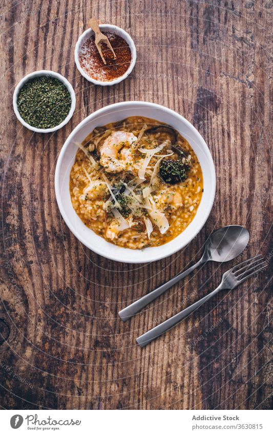 Dish of risotto with seafood rice meal plate cuisine top view italian shrimp dish gourmet delicious mediterranean dinner restaurant lunch recipe traditional