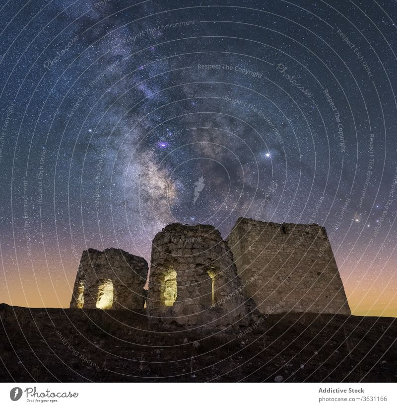 Castle in the mountains under the Milky Way castle milky way night rock rough landscape sky twilight nature wild galaxy spectacular scenery travel adventure