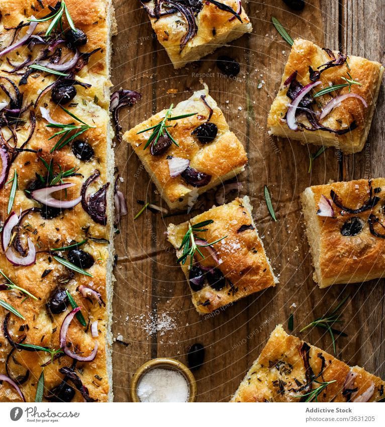 Focaccia with black olives and herbs on wooden table focaccia bread yeast italian bread ingredient handmade onions cooking italian focaccia with herbs