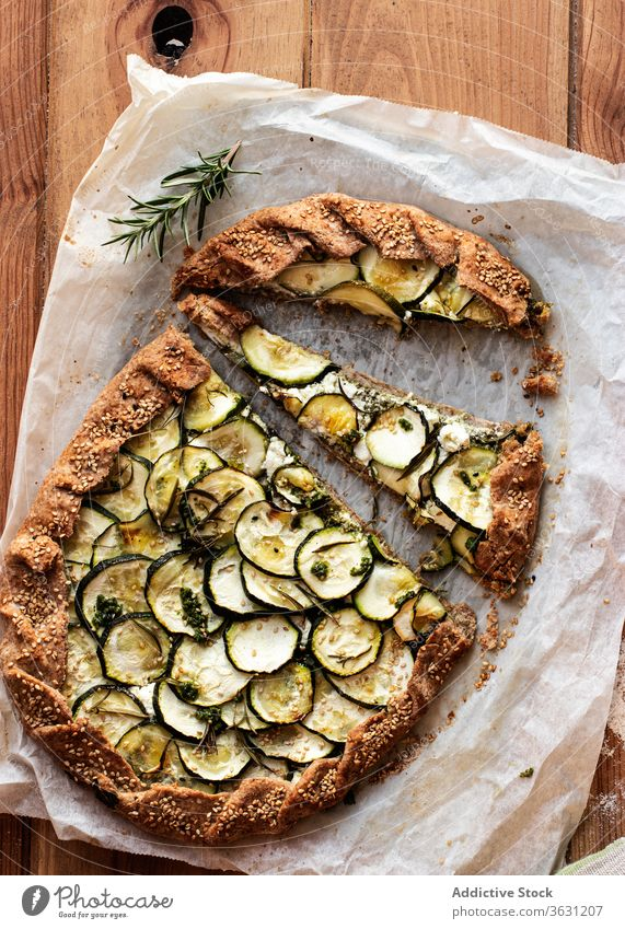 Zucchini galette on wooden table nutritionist tasty brunch feta cheese seasonal vegan cooking recipe healthy eating appetizers dining baked parchment paper