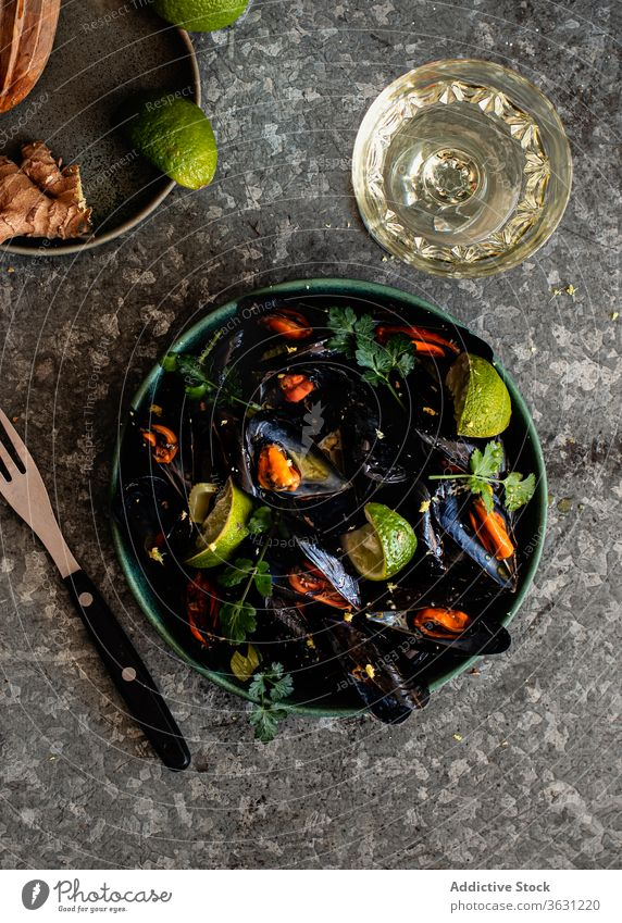 Steamed mussels in bowl on the table top view herbs food photography ginger steam spicy background mollusk menu wine meal steamed eating delicatessen prepared