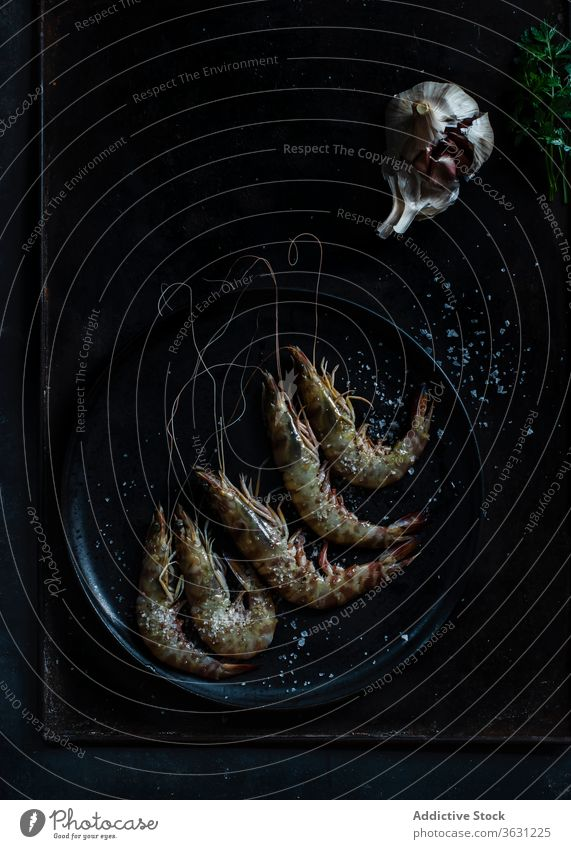 Prawns served in plate on table on dark background dark mood sea food plate seafood raw fish prawns cold culinary marine cooking appetizer delicious top fresh
