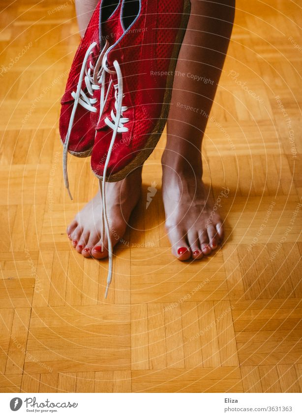 The legs and feet of a woman and red sneakers foot Barefoot Red Woman Legs red nail polish Varnished Zegnails Feminine Nail polish Skin sweaty feet Footwear