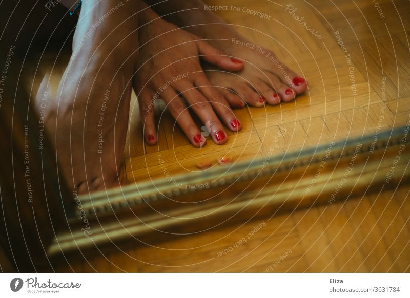 Feet and hand with red painted nails in front of a mirror foot red nails Nail polish Pedicure Varnished toenails Barefoot Red Feminine Legs Skin Ground floor