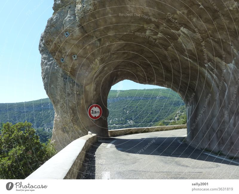 constrictive narrow Tunnel Breakthrough Street mountain road Road sign Lanes & trails Asphalt Traffic route Mountain rock Ledge passage Height control