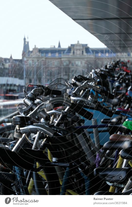 Bicycle parking lot in Amsterdam, Netherlands amsterdam background bicycle bicycles bike dutch europe holland netherlands parking space rows of bicycles station