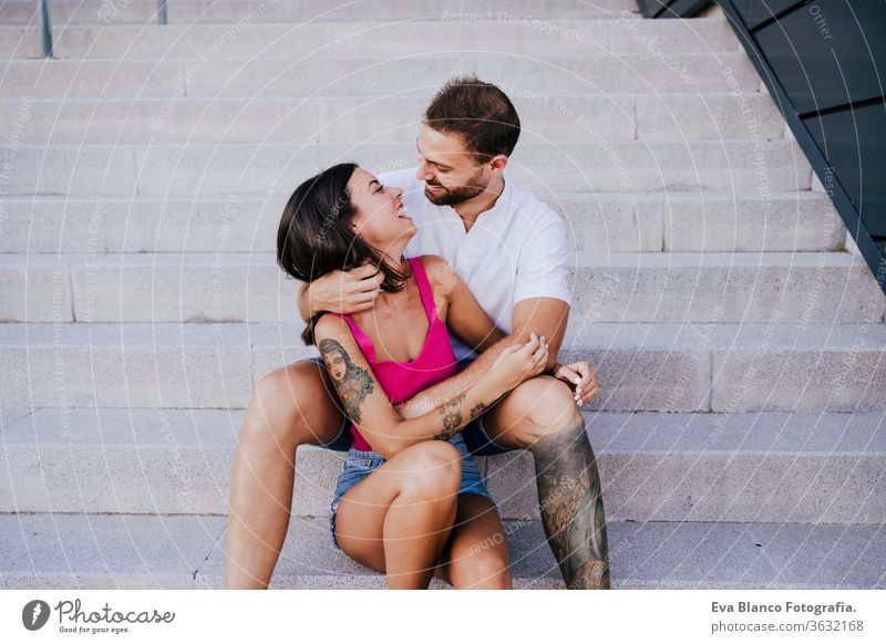 happy young couple outdoors. Family and love concept city lifestyle together togetherness tattoo caucasian female 2 woman romance summer girl smiling travel