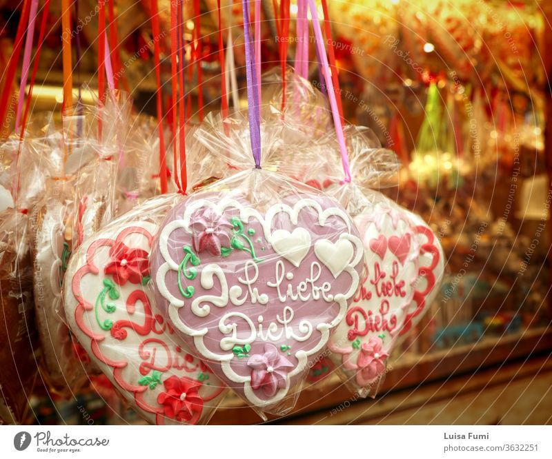 MUNICH, GERMANY - Traditional gingerbread hearts with sugar decorations of  'I love you' in German (Ich liebe Dich) on sale at the Oktoberfest in Munich food