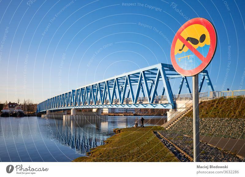No swimming sign by Odra River in Szczecin sunset, Poland. no swimming river city bridge water danger warning sky blue Brdowski Bridge Stettin Europe transport