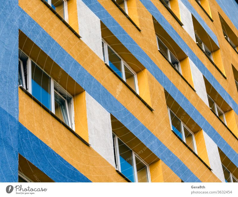 modern house with yellow and blue walls and empty windows Ukraine Apartment Apartments Architecture background Blue bottom view built City colourful