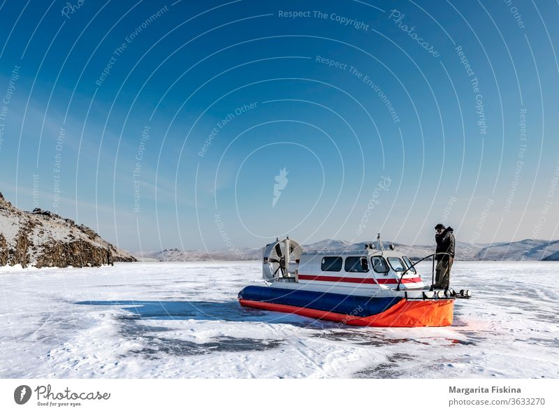 Hovercraft on the lake in winter air baikal blue boat cold combat cushion fast force landscape lcac marine motor nature outdoor propeller river sea shore