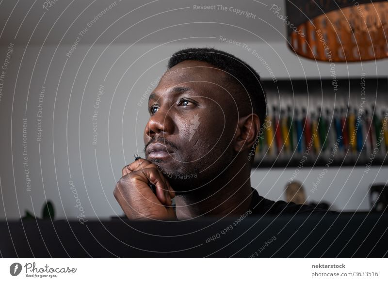 Portrait of Black Man Thinking with Hand on Chin man 1 person hand on chin African ethnicity lifestyle 20-30 years old handsome domestic life young man male