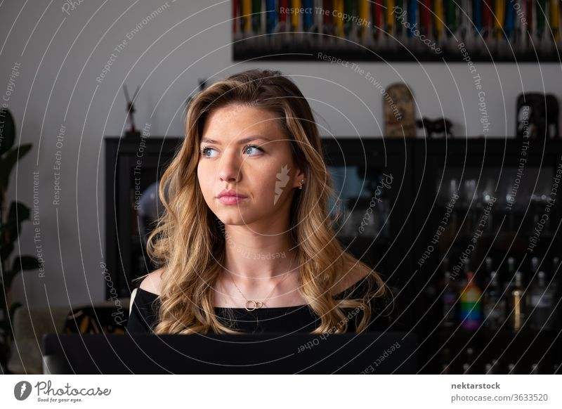 Young Blond Woman Looking Away in Living Room Portrait woman lifestyle blond young woman one woman only domestic life caucasian ethnicity 20-30 years old
