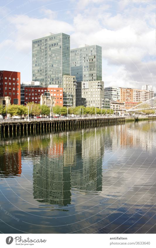 Symmetry | Mirror Worlds II neat clear Reflection in the water Water reflection Clouds Promenade River bank Housefront ria de bilbao Bilbao Town Exterior shot