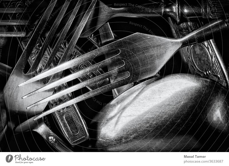 Abstract black and white photo of mixed silver forks, spoons and knives abstract closeup cutlery decorated decoration dining dinner effect food inox kitchen