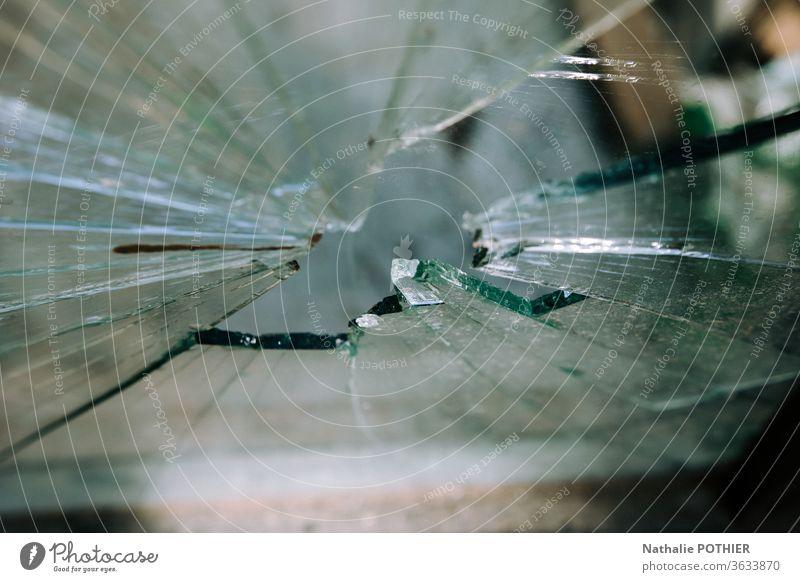 Broken glass broken glass Glass glass fragments Glass fragment Splinter Exterior shot Vandalism Close-up Detail Window Colour photo Destruction transparent