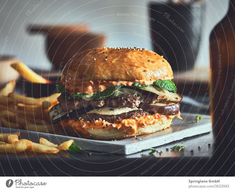 Mediterranean burger with fries Food & Drinks Fast food feed sb./sth. Meal Cheese Hamburger Cheeseburger Beef Burger Patty Meat selfmade BBQ