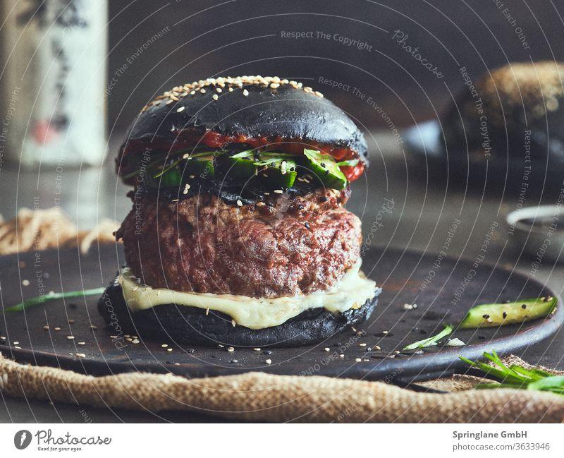 Black Bun Burger Asia Style burger Food & Drinks Fast food feed sb./sth. Meal Cheese Hamburger Cheeseburger Beef Burger Patty Meat selfmade BBQ