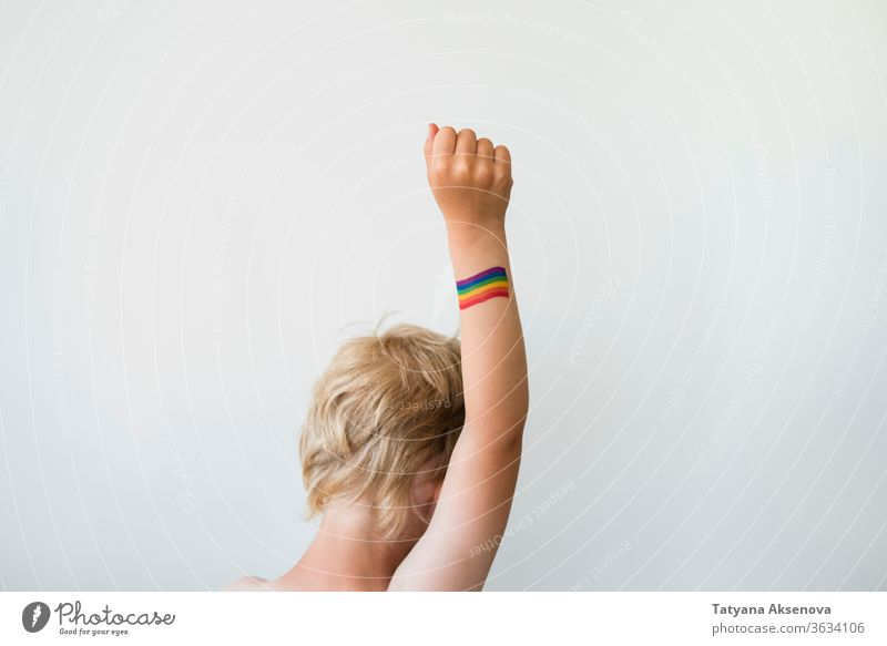 Rised child hand with rainbow LGBTQ pride flag tattoo lgbtq freedom gay lesbian homosexual symbol raised rights colorful bisexual love homosexuality concept