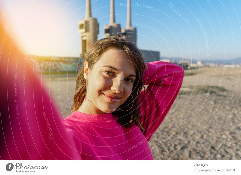 Attractive young woman taking a selfie in the beach female outside 1 outdoors beautiful photo portrait attractive girl city happy lifestyle person adult