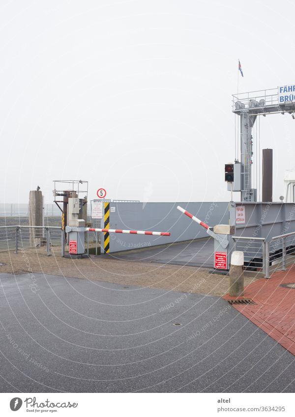 Departure 18:34 ferry bridge Ferry Off-Season Control barrier nebula Fog Ski-run Arrival North Sea North Sea Islands Harbour Wait Loneliness Passenger traffic