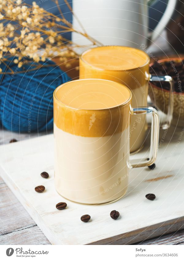 Whipped dalgona coffee drink in mug beverage sweet whipped caffeine latte wooden korean glass brown cup delicious trendy white board cold food sugar creamy foam