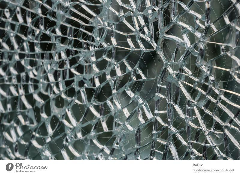 Detail of a broken window of a telephone booth. Pane Crack & Rip & Tear glass break Optics Lens technique Light Refraction light Floodlight signal lamp assembly