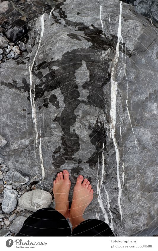 wet feet with footprints on rocks with white parallel lines Flowstone Line track search Tracks Stone stones Pebble dash White Parallel parallels Side by side
