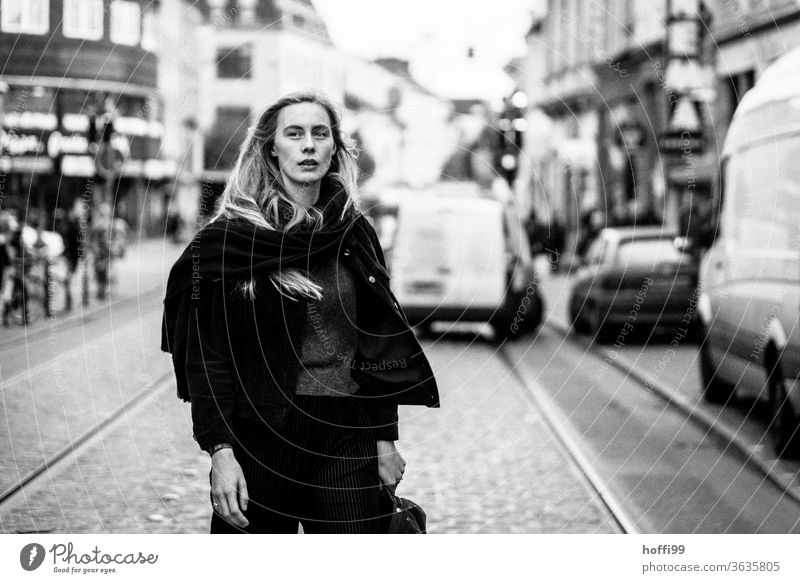 the woman crosses the street and looks sceptically about the coming... Feminine Woman Head Face of a woman Young woman 18 - 30 years Meditative Blonde Adults