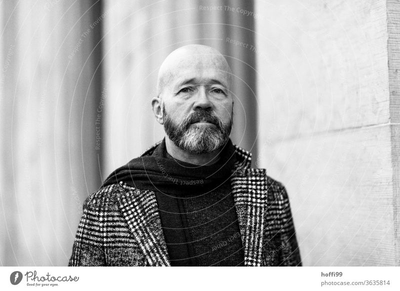 the man looks sceptically at the coming Man Facial hair Beard Coat Baldy Adults Masculine Human being portrait 1 Looking into the camera Exterior shot Face Head