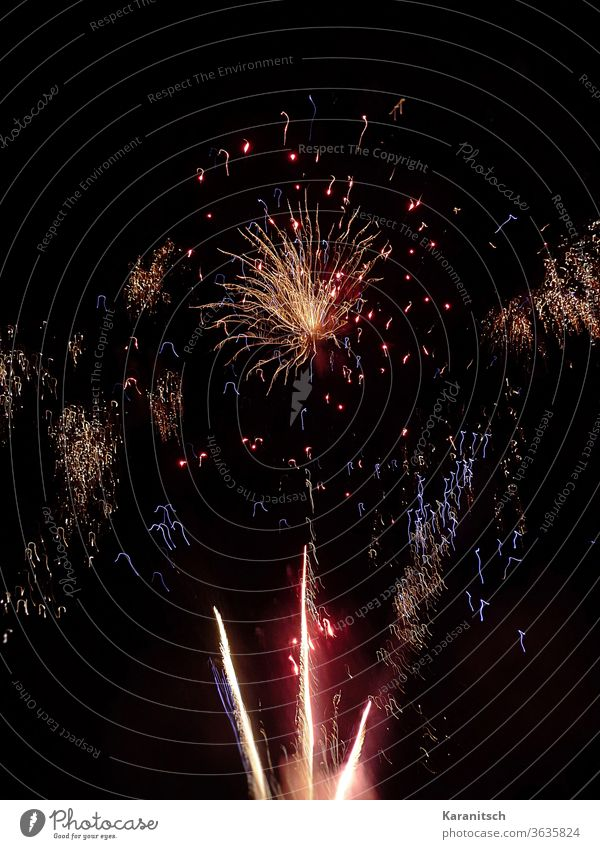 Start into the new year with fireworks Firecracker Firework Rockets Spark sparkle Flash Explosion Illuminate celebration Firm New Year New Year's Eve Tradition