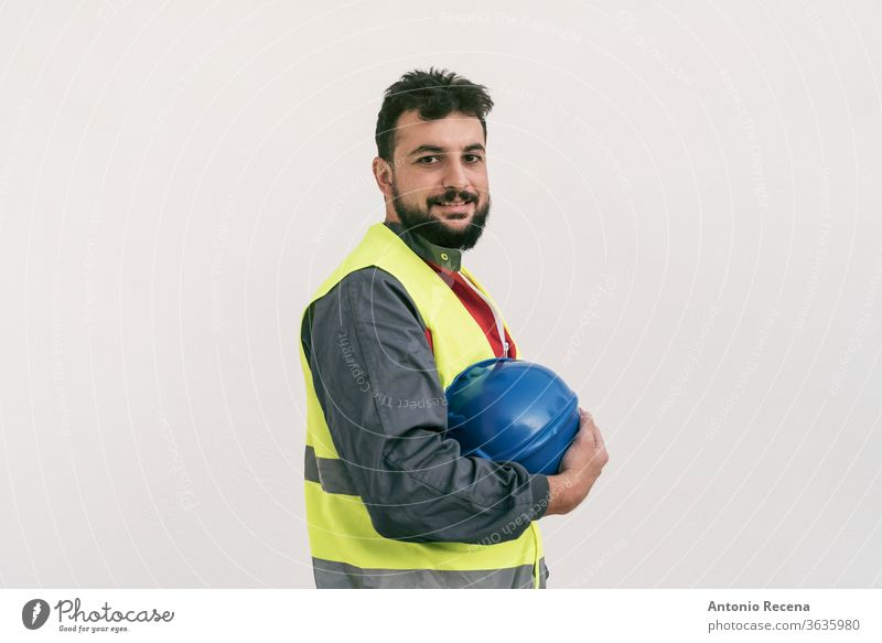Construction worker portrait on white wall posing construction man bearded middle eastern professional outdoors white background people person 30s 40s