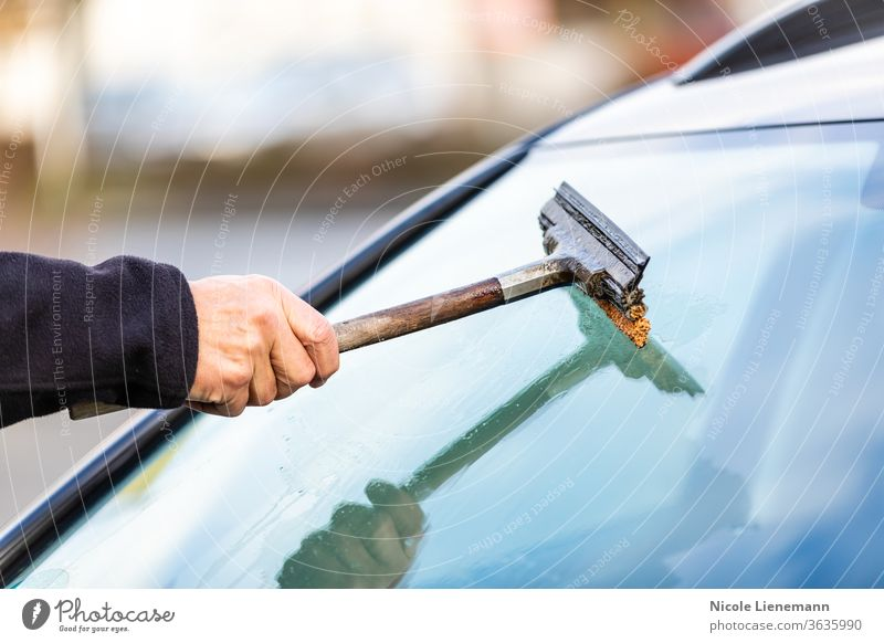 Clean the car window with a puller work worker preparer preparation auto automobile car care car shampoo car wash exterior operation dirt remove outside