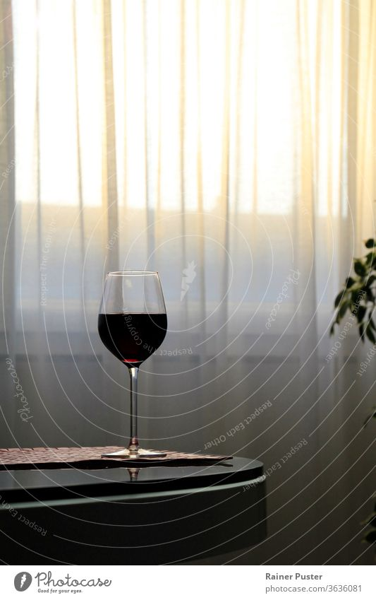 Glass of red wine on table while the sun sets alcohol background bar beverage celebration crystal culture drink edge elegant expensive glass gourmet grape