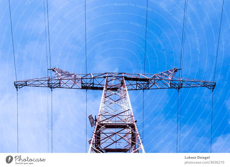 View of the power grid pylon on a sunny spring day cable danger distribution electrical electricity engineering environment equipment high industrial industry