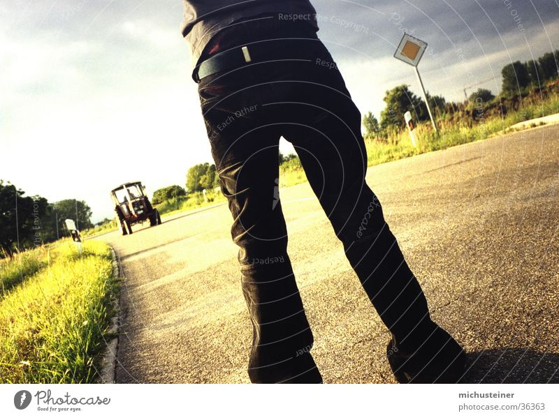 tractor stop Hitchhike Tractor Stand Snapshot Style Pants Street sign Flexible Photographic technology Human being stops Lighting Wait Funny fearless