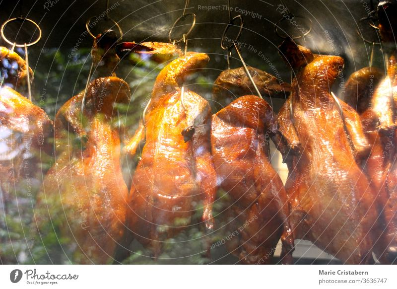 Peking duck, a traditional dish from Beijing that has been prepared since the imperial era peking duck traditional Chinese food poultry cooked grilled