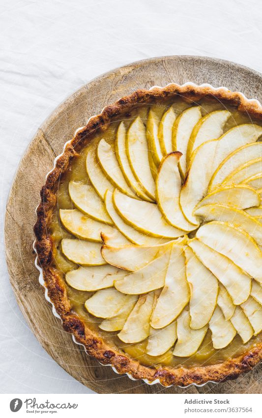 Delicious homemade apple pie in casserole dish yummy delicious dessert tasty table bakery pastry fruit green cloth food slice white baked sweet fresh cake