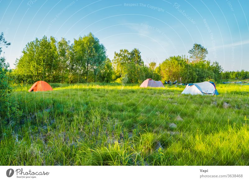 Tent camping on green grass field sunset tent forest mountain sky nature hiking adventure travel landscape tourism sunrise summer scene morning outdoor scenics