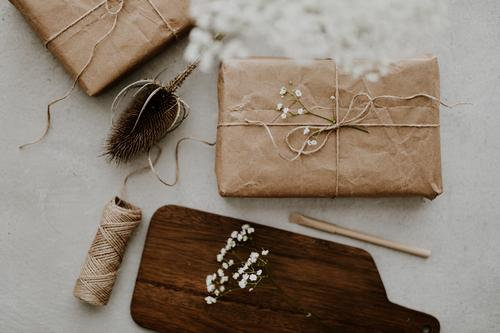 Gift wrapped in ecofriendly recycled paper with dried flowers and string gift eco friendly diy background beige surprise christmas birthday box handmade